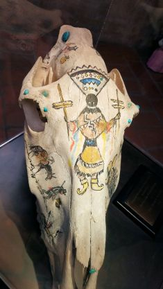 DeGrazia - Painting on a Burro Skull