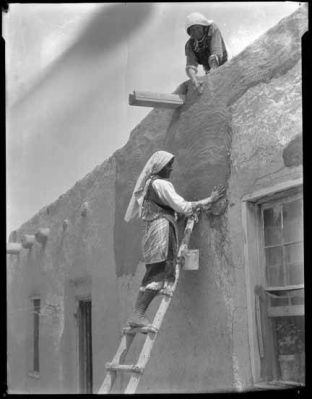 Laguna Pueblo Woman Plastering Homes